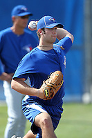 Toronto Blue Jays pitcher Daniel Norris #31 throws in the bullpen as coaches look on during minor league practice at the Englebert Minor League Complex on February 27, 2012 in Dunedin, Florida.  (Mike Janes/Four Seam Images)