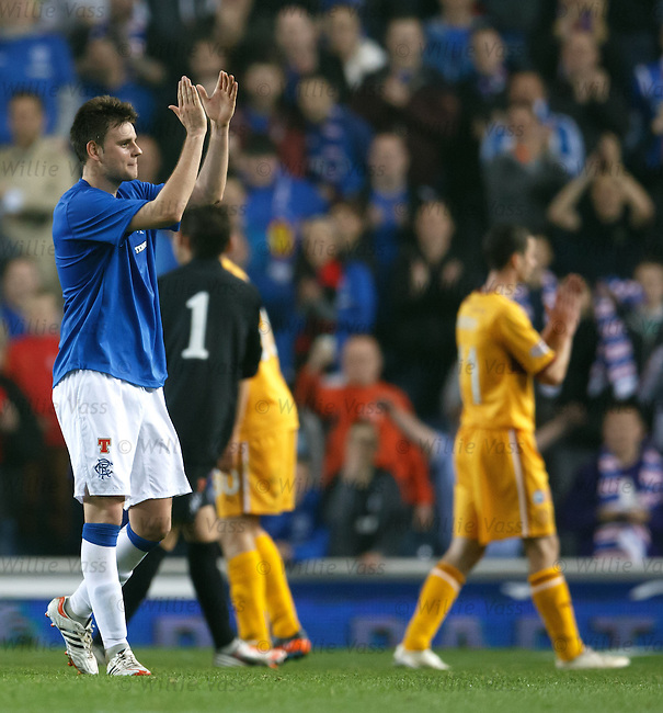 A clearly emotional Sebastien Faure applauds the Rangers support after full-time