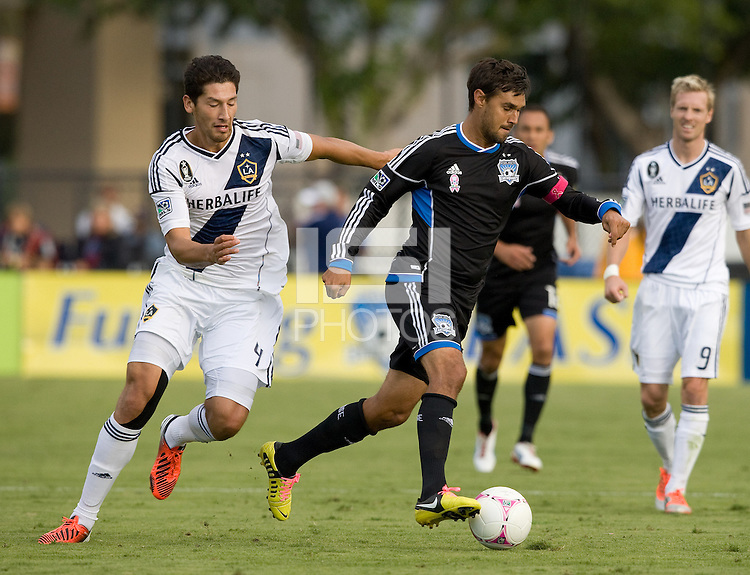 Chris Wondolowski of Earthquakes controls the ball away from Omar Gonzalez of Galaxy during the game at Buck Shaw Stadium in Santa Clara, California on October 21st, 2012.  San Jose Earthquakes and Los Angeles Galaxy tied at 2-2.