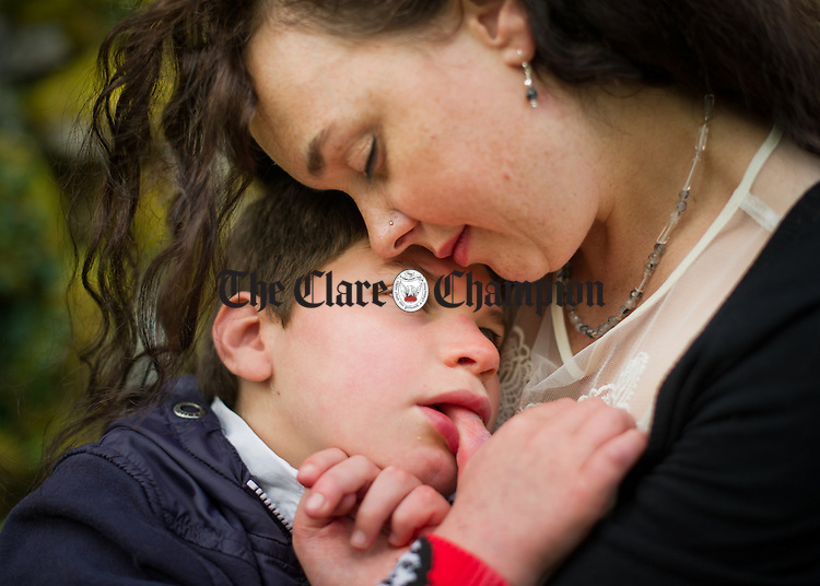 Che O Grady in the arms of  his mother Sonja Devine at the Che Kinvara fundraising event in the Burren Nature Sanctuary at Kinvara. Photograph by John Kelly.