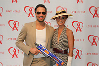 Eric and Caroline Villency attend The Let's Misbehave Party to Benefit Love Heals on July 19, 2014 (Photo By Taylor Donohue/Guest Of A Guest)