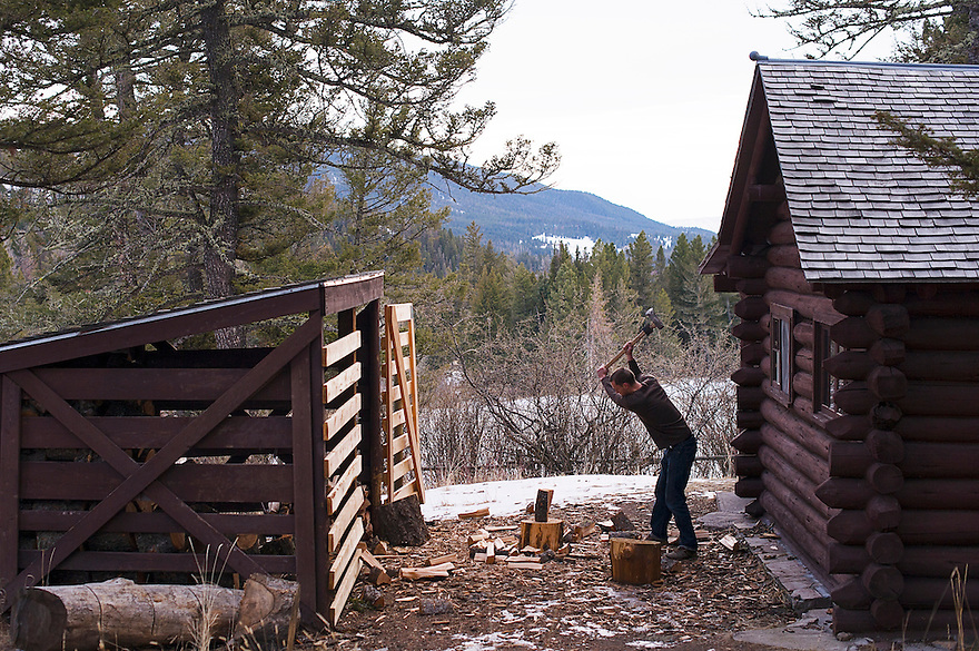 A man chops wood at the Battle Ridge Cabin in the Bridger Mountains near Bozeman, Montana.