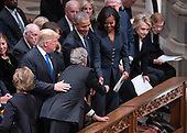 Former United States President George W. Bush reaches for the hand of former first lady Michelle Obama as he arrives for the National funeral service in honor of the late former US President George H.W. Bush at the Washington National Cathedral in Washington, DC on Wednesday, December 5, 2018.  Also pictured are US President Donald J. Trump, former US President Barack Obama, former US Secretary of State Hillary Rodham Clinton, and former first lady Rosalynn Carter.<br /> Credit: Ron Sachs / CNP<br /> (RESTRICTION: NO New York or New Jersey Newspapers or newspapers within a 75 mile radius of New York City)