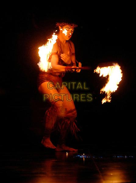 "CIRQUE DU SOLEIL.""Algeria""  show.Royal Albert Hall, Kensington.London England  4th January 2007.fire act full length.CAP/PL.©Phil Loftus/Capital Pictures"