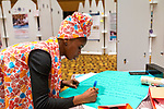 27 June, 2018, Kuala Lumpur, Malaysia : A participant signs a poster at The Village during the third day at the Girls Not Brides Global Meeting 2018 at the Kuala Lumpur Convention Centre. Picture by Graham Crouch/Girls Not Brides