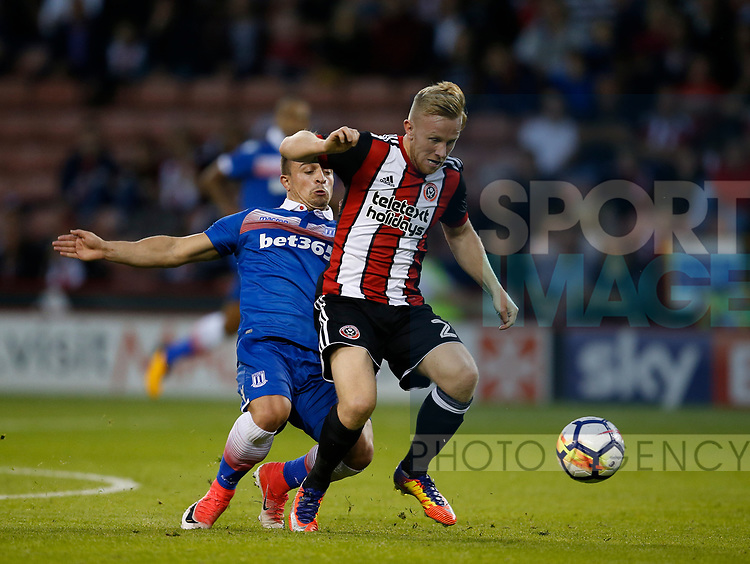 Xherdan Shaqiri of Stoke City tackles Mark Duffy of Sheffield Utd during the pre season friendly at Bramall Lane Stadium, Sheffield. Picture date: July 25th 2017. Picture credit should read: Simon Bellis/Sportimage