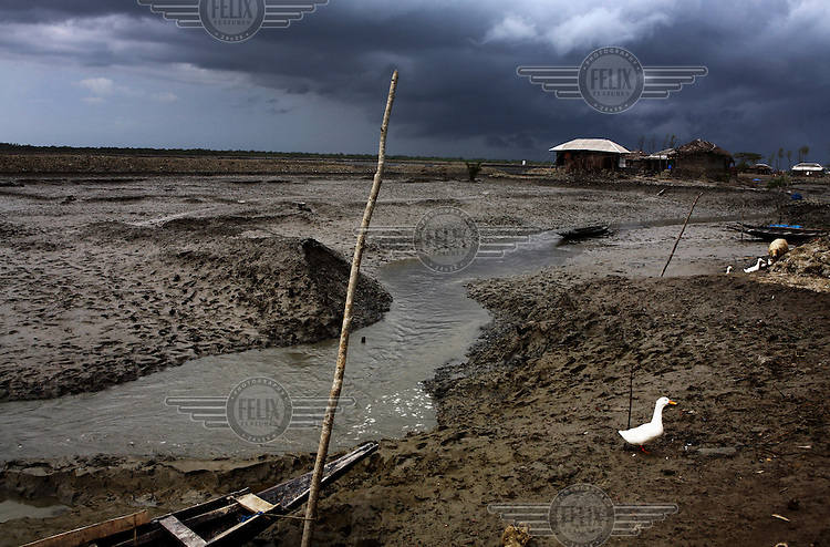 Cyclone Aila has left the village of Shyamnagar in a desolate silence in May of 2009. At least 275 people lost their lives in the region and millions were displaced as the storm rolled over coastal Bangladesh and eastern India.