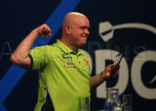27.12.2016. Alexandra Palace, London, England. William Hill PDC World Darts Championship. Michael van Gerwen punches the air and celebrates beating Cristo Reyes 4 sets to 2
