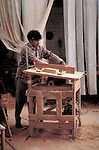Peruvian furniture builder using home made table saw.