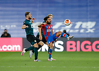 29th June 2020; Selhurst Park, London, England; English Premier League Football, Crystal Palace versus Burnley Football Club; Andros Townsend of Crystal Palace clears the ball out over Erik Pieters and Charlie Taylor of Burnley