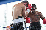 Jason Escalera from Union City, NJ, right, fights Norbert Nemesapati from Budapest, Hungary during the Super Middleweight match of the Rural Rumble on Friday night, August 8, 2014 at Churchill County Fairgrounds in Fallon, Nevada.