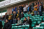 Some of the 79 visiting fans watching the first-half action at Easter Road stadium during the Scottish Championship match between Hibernian and visitors Alloa Athletic. The home team won the game by 3-0, watched by a crowd of 7,774. It was the Edinburgh club's second season in the second tier of Scottish football following their relegation from the Premiership in 2013-14.