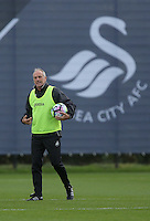 Manager Francesco Guidolin gives instructions to his players during the Swansea City FC Training at Fairwood Training Ground on September 8, 2016 in Swansea, Wales.