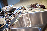 Stainless Steel Sink and Chrome Faucet Stock Photo