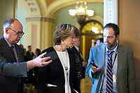 United States Senator Lisa Murkowski (Republican of Alaska) speaks with reporters outside the US Senate chamber in the US Capitol in Washington, DC on Friday, December 1, 2017. Photo Credit: Alex Edelman/CNP/AdMedia