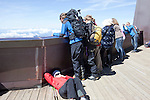 Mountain Climbers taking a break after coming off of Mont-Blanc at Aguille du Midi, Chamonix-Mont-Blanc, France