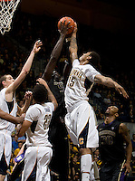 Richard Solomon of California tries to steal a loose ball during the game against Washington at Haas Pavilion in Berkeley, California on January 9th, 2013.   Washington defeated California, 62-47.