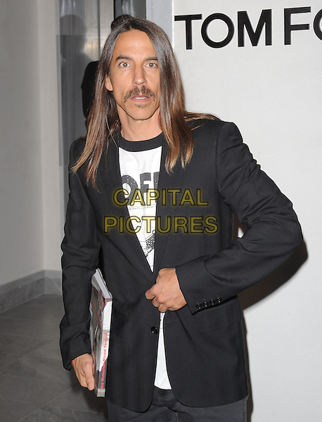 ANTHONY KIEDIS of the Red Hot Chili Peppers.The Opening of The Tom Ford Beverly Hills Store in Beverly Hills, California, USA..February 24th, 2011.half length black suit jacket white top moustache mustache facial hair .CAP/RKE/DVS.©DVS/RockinExposures/Capital Pictures.