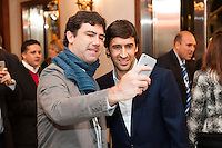 NEW YORK, NY - Sunday February 21, 2016: Real Madrid stand-out Raul takes photos with guests during the Copa America Centenario draw ceremony at the Hammerstein Ballroom in midtown Manhattan, New York City.