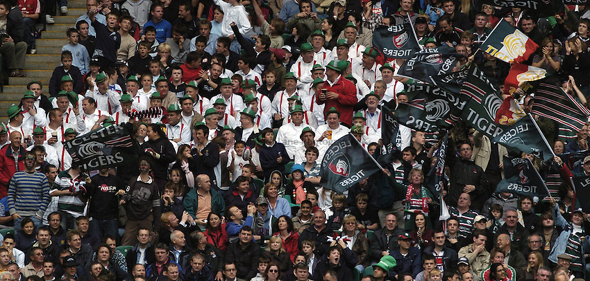 Photo: Jonathan Butler..Gloucester Rugby v Leicester Tigers. Guinness Premiership Final. 12/05/2007..Two sides of story is represented in the fans reactions Leicester fans on the right cheer on another Tigers try as Gloucester fans try to put a brave face on todays proceedings.