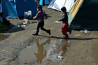 Pictured: Children play in the camp  Tuesday 01 March 2016<br /> Re: Thousands of migrants, still stranded at the Greek FYRO Macedonian border in Idomeni, Greece