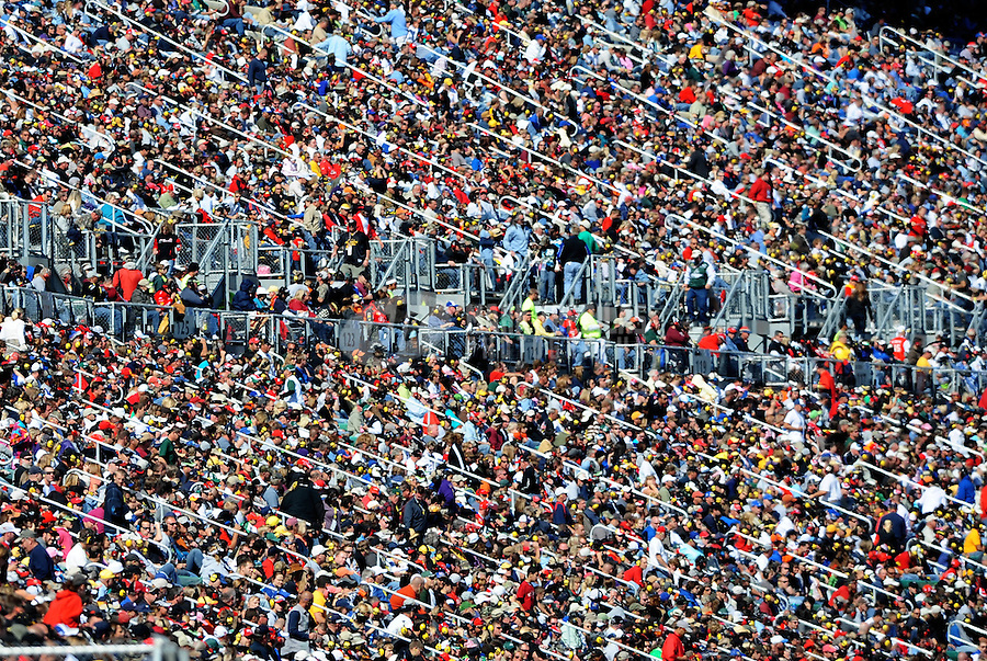 Oct. 3, 2010; Kansas City, KS, USA; NASCAR Sprint Cup Series fans in the grandstands during the Price Chopper 400 at Kansas Speedway. Mandatory Credit: Mark J. Rebilas-