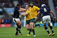 Bernard Foley of Australia takes on the Scotland defence. Rugby World Cup Quarter Final between Australia and Scotland on October 18, 2015 at Twickenham Stadium in London, England. Photo by: Patrick Khachfe / Onside Images
