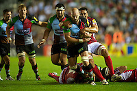 George Robson of Harlequins is tackled by Daniel Browne of London Welsh during the Aviva Premiership match between Harlequins and London Welsh at the Twickenham Stoop on Friday 7th September 2012 (Photo by Rob Munro)