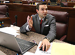 Nevada Assemblyman Derek Armstrong, R-Las Vegas, answers media questions on the Assembly floor at the Legislative Building in Carson City, Nev., on Sunday, May 31, 2015.  <br /> Photo by Cathleen Allison