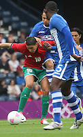 Men's Olympic Football match Honduras v Morocco on 26.7.12...Abdelaziz Barrada of Morocco being challenged by Maynor Figuero of Honduras, during the Honduras v Morocco Men's Olympic Football match at Hampden Park, Glasgow............