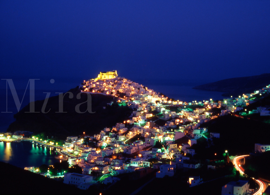 Greece. Astypalaia. The Fortified town of Chora at night overlooking Skala harbor.