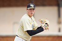 Wake Forest Demon Deacons starting pitcher Max Tishman (34) warms up in the bullpen prior to the game against the Marshall Thundering Herd at Wake Forest Baseball Park on February 17, 2014 in Winston-Salem, North Carolina.  The Demon Deacons defeated the Thundering Herd 4-3.  (Brian Westerholt/Four Seam Images)