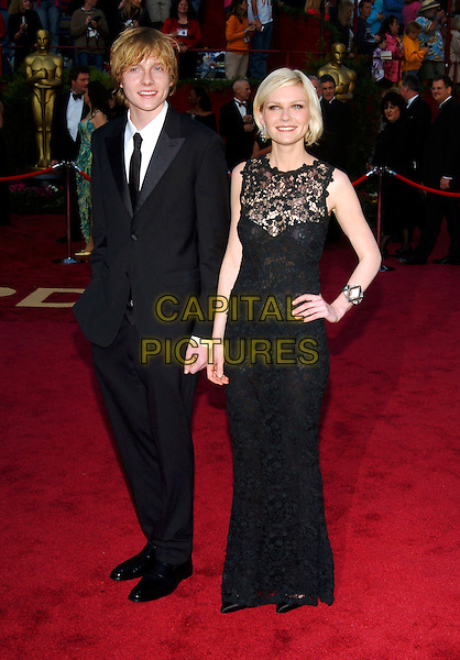 CHRISTIAN DUNST & KIRSTEN DUNST.Red Carpet Arrivals, 77th Annual Academy Awards held at the Kodak Theatre, Hollywood, California, USA, .27th February 2005.  .oscars full length brother sister family black dress lace sheer see through top hand on hip bob bobbed hair.Ref: ADM.www.capitalpictures.com.sales@capitalpictures.com.©JWong/AdMedia/Capital Pictures