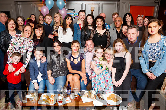 Nicole O'Sullivan and Declan O'Brien seated front centre, enjoying their party with family and friends at No 4 The Square on Saturday night before the head to Asia and Australia in the coming weeks.