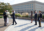 United States President Barack Obama lays a wreath at the Pentagon to mark the 13th anniversary of the September 11th, 2001 terrorist attacks, in Washington, Thursday, Sept. 11, 2014. Shown with the president are first lady Michelle Obama, U.S. Secretary of Defense Chuck Hagel, and the Chairman of the Joint Chiefs of Staff, General Martin E.  Dempsey, U.S. Army.<br /> Credit: Martin Simon / Pool via CNP