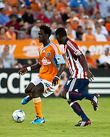 Houston Dynamo forward Kei Kamara (10) attempts to shoot around Chivas USA defender Shavar Thomas (4).  Houston Dynamo defeated CD Chivas USA 1-0 at Robertson Stadium in Houston, TX on June 10, 2009.