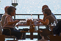 Two senior citizens couples lunching. YaMas restaurant on the waterfront. Thessaloniki, Macedonia, Greece