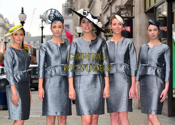 Amber Le Bon & models.British model Amber Le Bon launches Royal Ascot's 2013 Dress Code Assistants' outfits, supplied by Hobbs London, Hobbs, London, England..May 22nd, 2013.half 3/4 length grey gray dress skirt blazer jacket hat peplum     .CAP/BF.©Bob Fidgeon/Capital Pictures