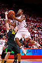 23 November 2011: Dylan Talley #24 of the Nebraska Cornhuskers lays up the ball against E.J. Singler #25 of the Oregon Ducks at the Devaney Sports Center in Lincoln, Nebraska. Oregon defeated Nebraska 83 to 76.