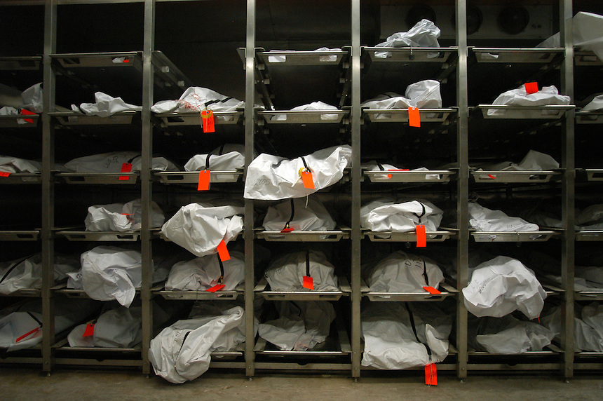 Bodies in various stages of decomposition fill the refrigerated shelves at the Pima County Forensics Science Center in Tucson on Wednesday, August 3, 2005. Due to the high numbers of deaths among migrants passing through the region this year, the center has been filled past capacity and has had to rent a refrigerated truck to store bodies.