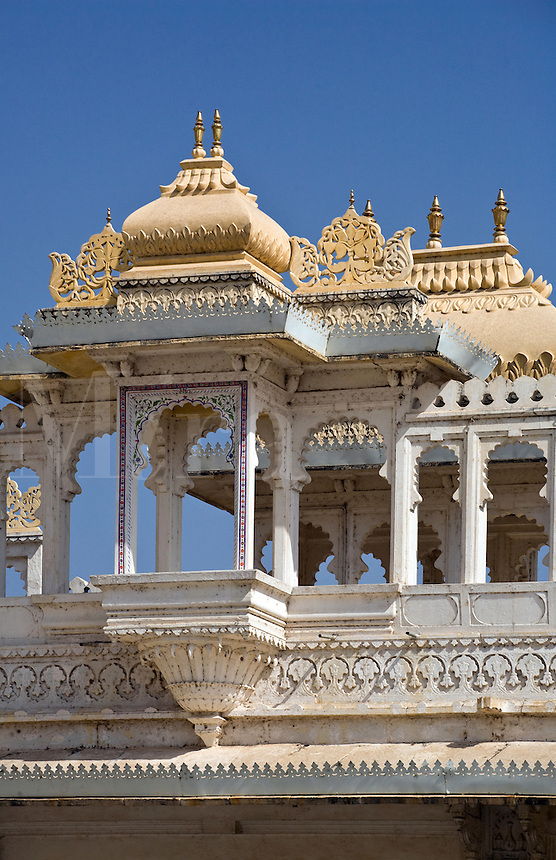 CUPOLAS carved of stone atop the TRIPOLIA GATE where one enters the CITY PALACE of UDAIPUR built by various Maharajas starting in 1600 AD - RAJASTHAN, INDIA