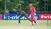 ICC World T20 Qualifier - GROUP B MATCH - CANADA V KENYA at Watsonians CC, Edinburgh - Kenya's Nelson Odhiambo bowls past Canada's Rizwan Cheema — credit @ICC/Donald MacLeod - 10.07.15 - 07702 319 738 -clanmacleod@btinternet.com - www.donald-macleod.com