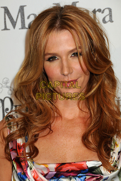 POPPY MONTGOMERY .3rd Annual Women In Film Pre-Oscar Party held at a Private Residence in Beverly Hills, California, USA, .4th March 2010..portrait headshot sleeveless  floral red white blue print flower ruched silk satin  .CAP/ADM/BP.©Byron Purvis/AdMedia/Capital Pictures.