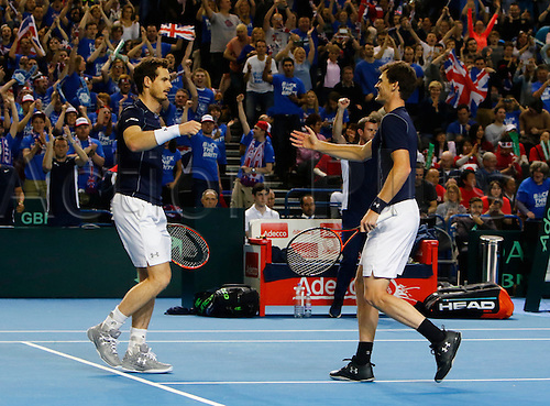 05.03.2016. Barclaycard Arena, Birmingham, England. Davis Cup Tennis World Group First Round. Great Britain versus Japan. Andy Murray congratulates his brother Jamie Murray at the end of their doubles match against Yoshihito Nishioka and Yasutaka Uchiyama. GB won in straight sets 6-3, 6-2,6-4.
