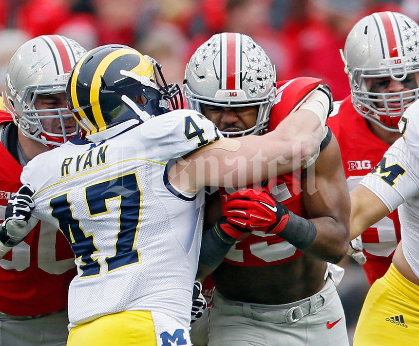 Ohio State Buckeyes running back Ezekiel Elliott (15) carries the ball against Michigan Wolverines linebacker Jake Ryan (47) in the 3rd quarter of their game at Ohio Stadium in Columbus, Ohio on November 29, 2014.  (Dispatch photo by Kyle Robertson)