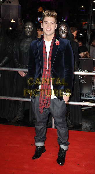 """AIDEN GRIMSHAW.""""Harry Potter And The Deathly Hallows: Part 1""""  World Film Premiere, .Empire cinema Leicester Square and Odeon Leicester Square, London, England, UK, 11th November 2010..full length black navy blue velvet jacket poppy red scarf grey gray trousers white shirt .CAP/WIZ.© Wizard/Capital Pictures."""