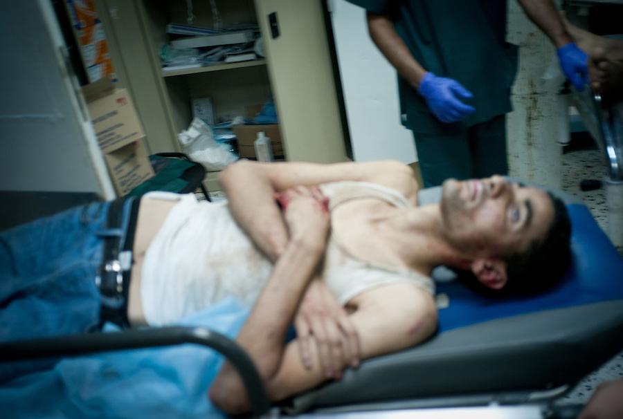 Rebel prisoner freed from storage container in Maya at Al-Zawiya Hospital, Zawiya, Libya