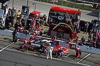 Tony Stewart (#14) makes a pit stop.