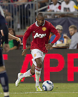 Manchester United FC forward Ashley Young (18) on the attack. In a Herbalife World Football Challenge 2011 friendly match, Manchester United FC defeated the New England Revolution, 4-1, at Gillette Stadium on July 13, 2011.