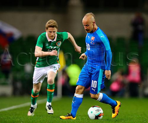 29.03.2016. Aviva Stadium, Dublin, Ireland. International Football Friendly Rep. of Ireland versus Slovakia. <br /> Miroslav Stoch (Slovakia) turns back as Eunan O&rsquo;Kane (Rep. of Ireland) closes in.